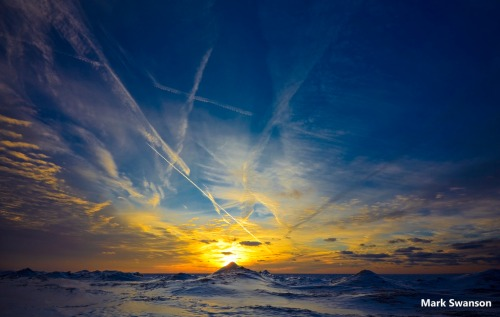 Contrail Sunset by Mark Swanson