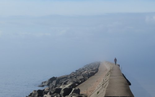 Walking the breakwater in the fog