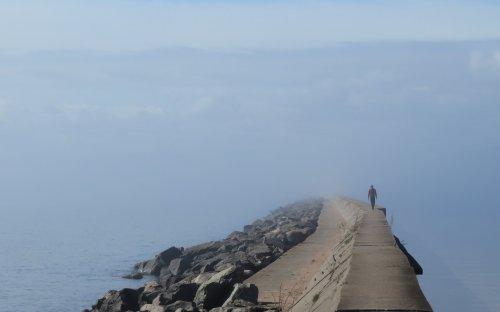Walking the breakwater in the fog