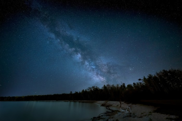 The Milky Way over Lake Michigan at Wilderness State Park by Diana Robinson