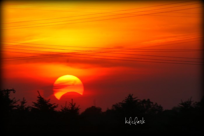 Sunset during a partial solar eclipse by Diane