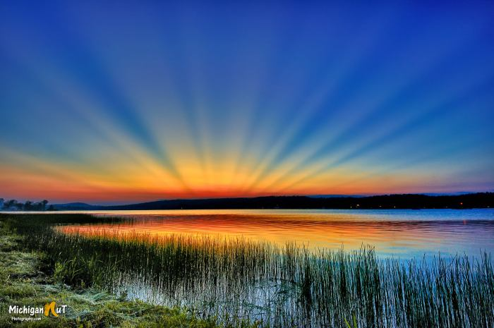 Crepuscular rays over Sunday Lake by Michigan Nut Photography